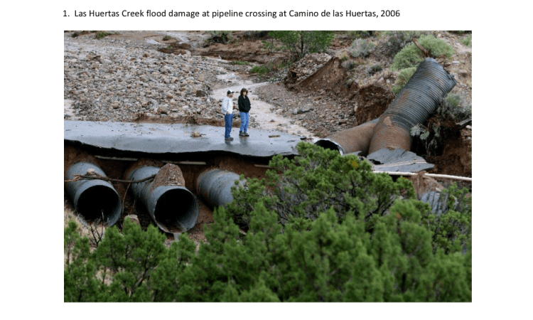 """Figure 1: Example of flood damage in Placitas, NM that ruptured """"underground"""" pipelines buried in a streambed"""