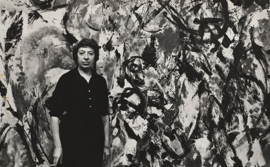 Fred W. McDarrah: Abstract Expressionist artist Lee Krasner, who was married to Jackson Pollock, in front of one of her paintings, February 26, 1961