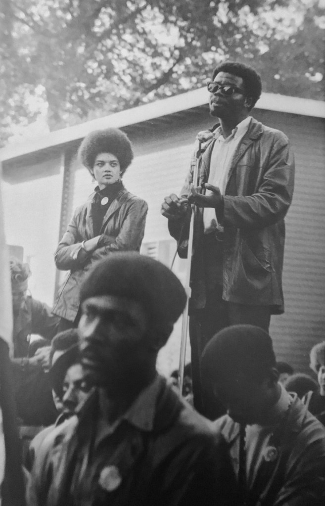 Stephen Shames, Kathleen Cleaver and George Murray, the Black Panther Party's Minister of Education, at a Free Huey rally, 1968