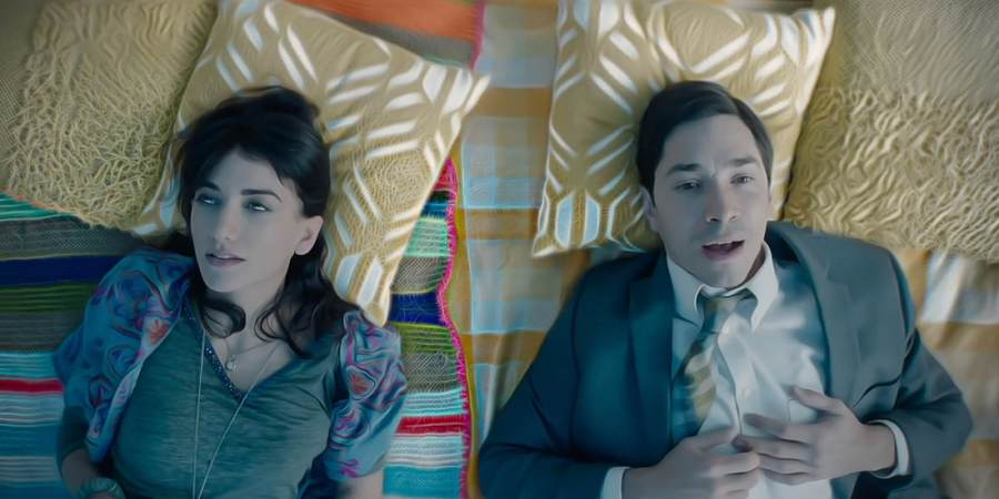Sheila Vand and Justin Long in The Wave (2019), reviewed at Riot Material magazine.