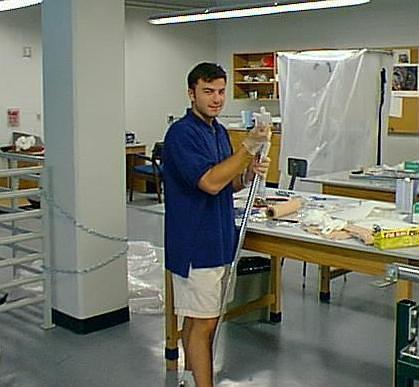 Dr. Dave Schroerlucke working in physics lab