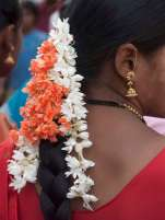 South Indian woman with typical flowers in her hair
