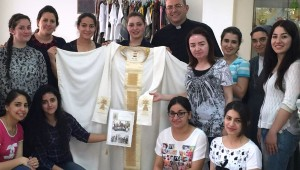 Iraqi refugee women who fled Islamic State group violence in their homeland pose for a photo in Amman, Jordan, in early June. The Chaldean Catholic women sent the hand-sewn mantle to Pope Francis and asked him to pray for them and for peace in their country. (CNS photo/courtesy Catholic Center for Studies and Media in Amman) See IRAQIS-POPE-MANTLE June 8, 2016. Editors: Best image available.