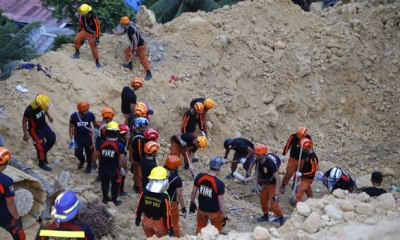 Landslides claim 21 lives in the Philippines, buries scores of houses