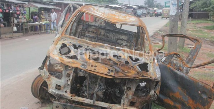 The burnt police truck. Photo by Patrick Egwu