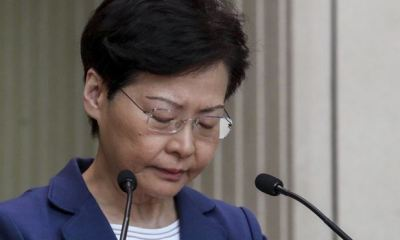 Hong Kong's Carrie Lam apologises for sparking crisis, says she would quit if she could