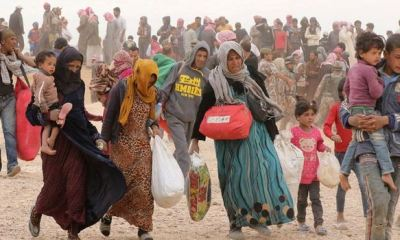 Thousands flee Syrian community as deadly bombings intensify