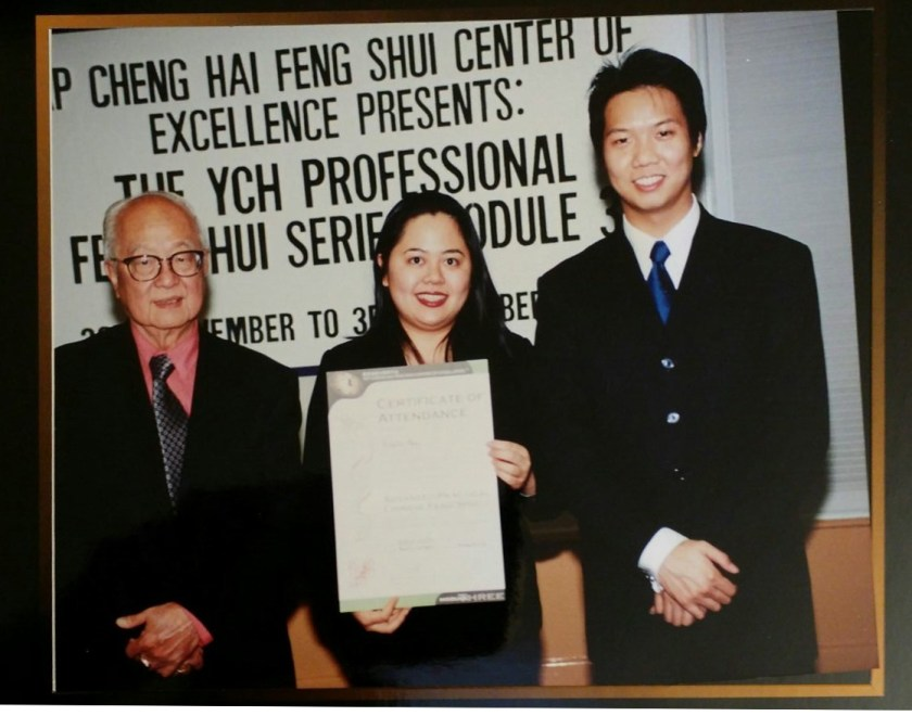 Me receiving a certificate for my Feng Shui studies with Grand Master Yap Cheng Hai and the young Joey Yap