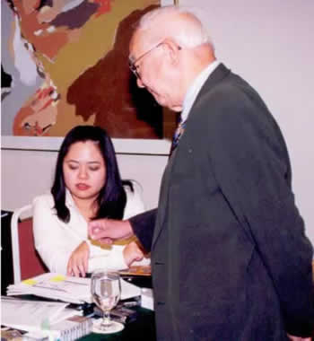 Master Angela Ang receiving instruction from Grand Master Yap Cheng Hai in the 1990s