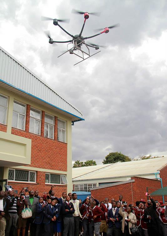 School children and guests take pictures of the drone during its test run. Photo: Aaron Ufumeli/News Day