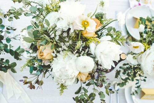 White and yellow floral arrangement for table centerpiece
