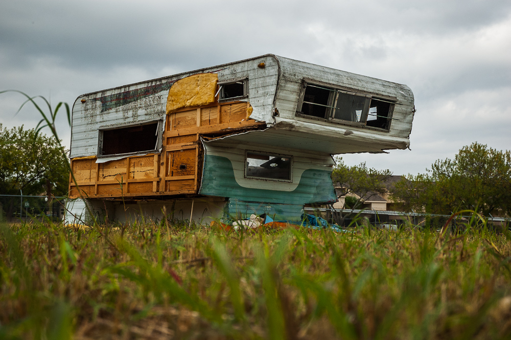 Truck Camper Abandoned In Field