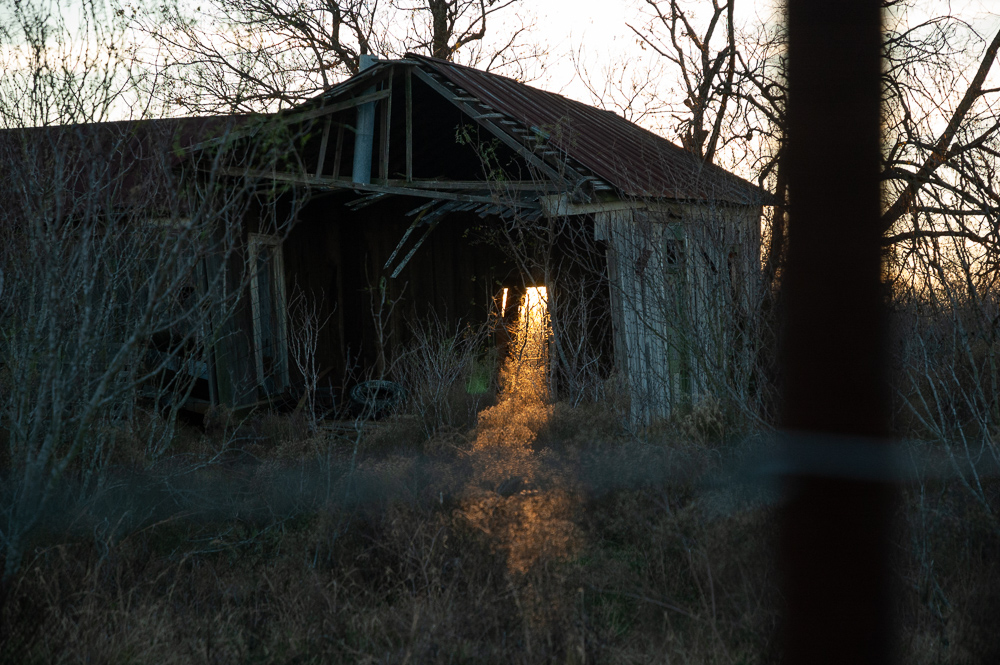 Twilight Shining Through Abandoned Barn