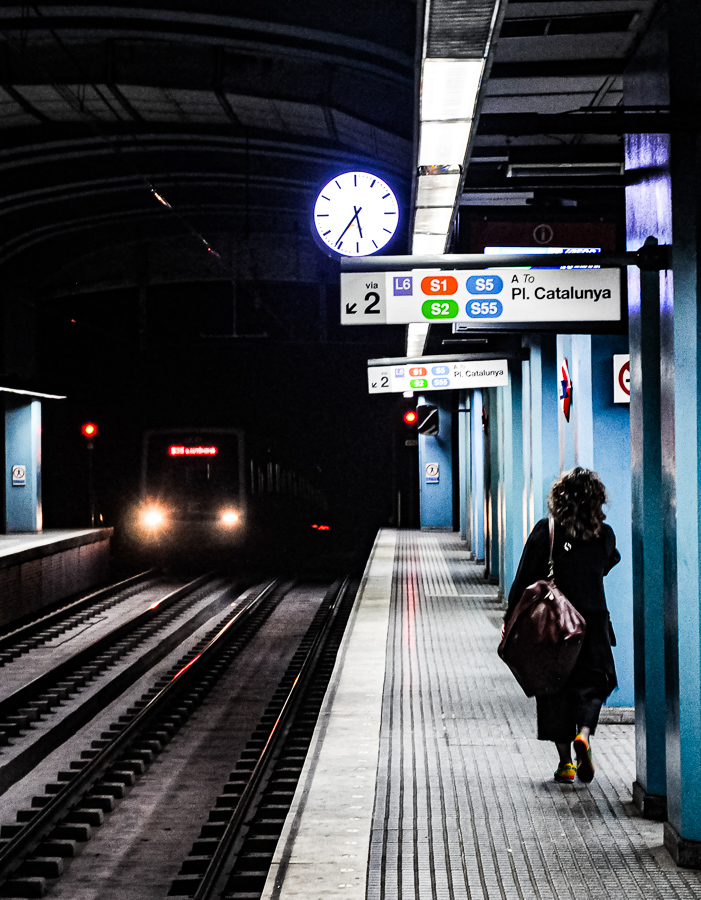 Subway - Lights in the distance - clock, woman