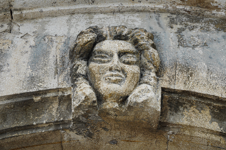France, stone head guarding the door