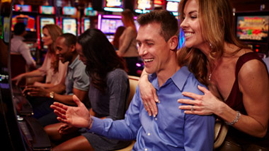 couple playing slots at River City Casino