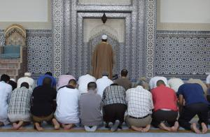 Members of the Muslim community attend midday prayers at Strasbourg Grand Mosque in Strasbourg