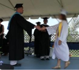 2014 0106 graduate handshake