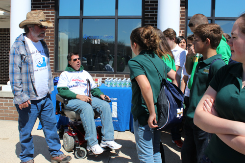 ALS victims Paul Weissman, left, and Frank Verdone, right, greet students from McGann-Mercy this morning. Photo: Katie Blasl.