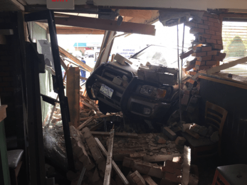 Vehicle plows into Riverhead Pizza Hut, driver and two