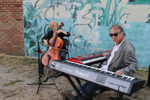 George Cork Maul and Jeannie Woelker perform on East Main Street.