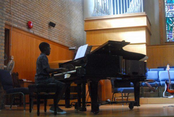 Preteen Boy Playing Piano