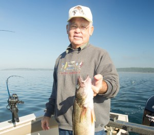 Larry McQuatter fishes for walleye at Bull Shoals Lake.