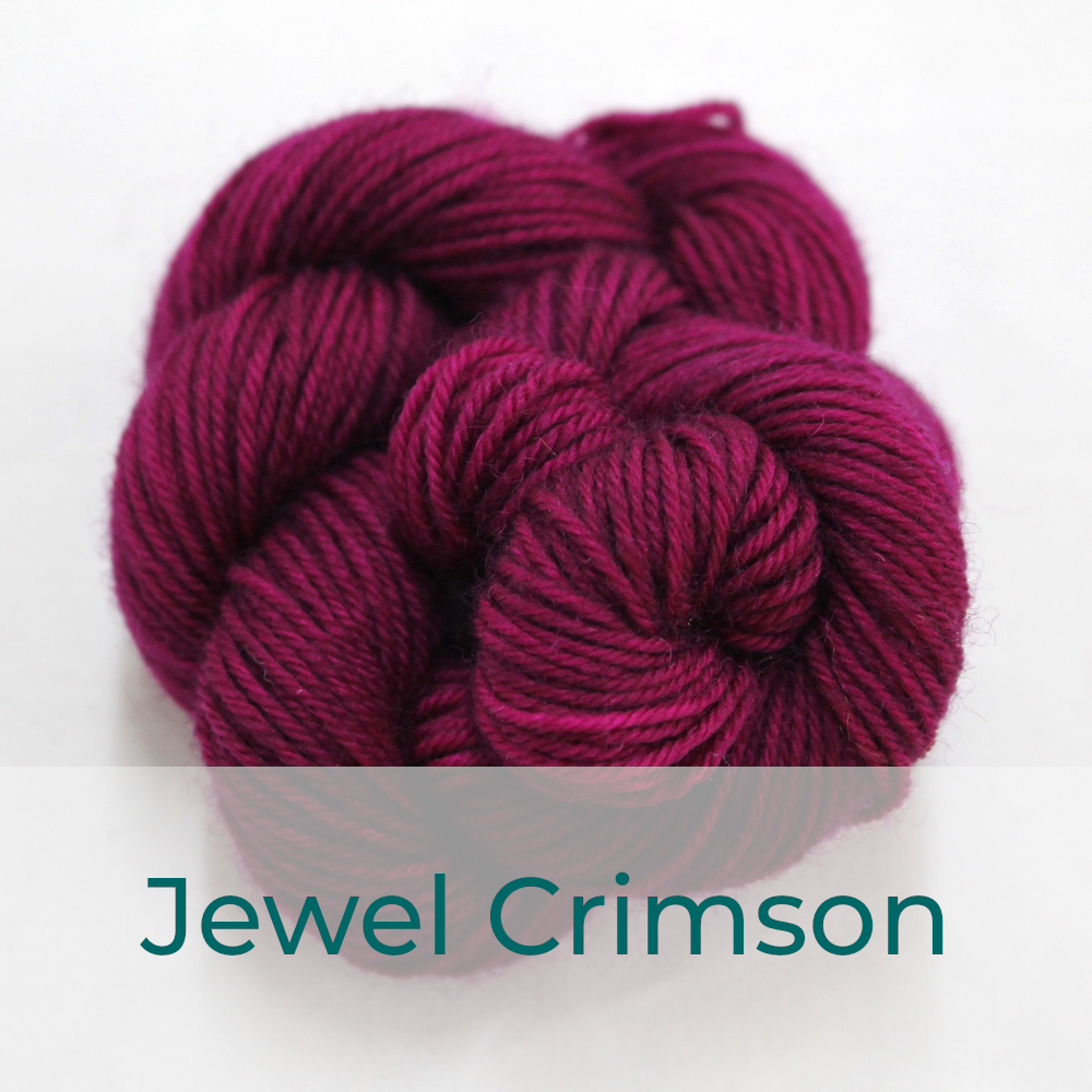 BFL 4 Ply mini skein in Jewel Crimson colourway. It is a deep pink.