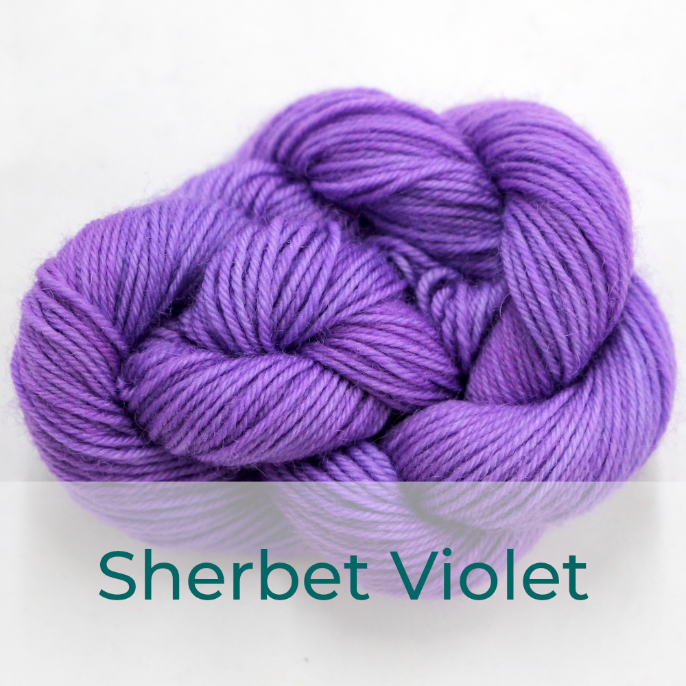 BFL 4 Ply mini skein in the Sherbet Violet colourway. It is light bright purple.