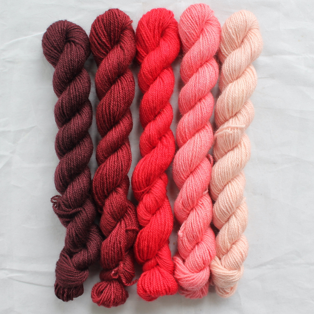 5 red mini skeins in a gradient from dark to light