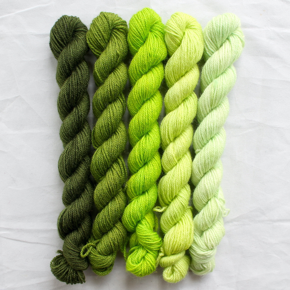 5 lime green mini skeins in a gradient from dark to light