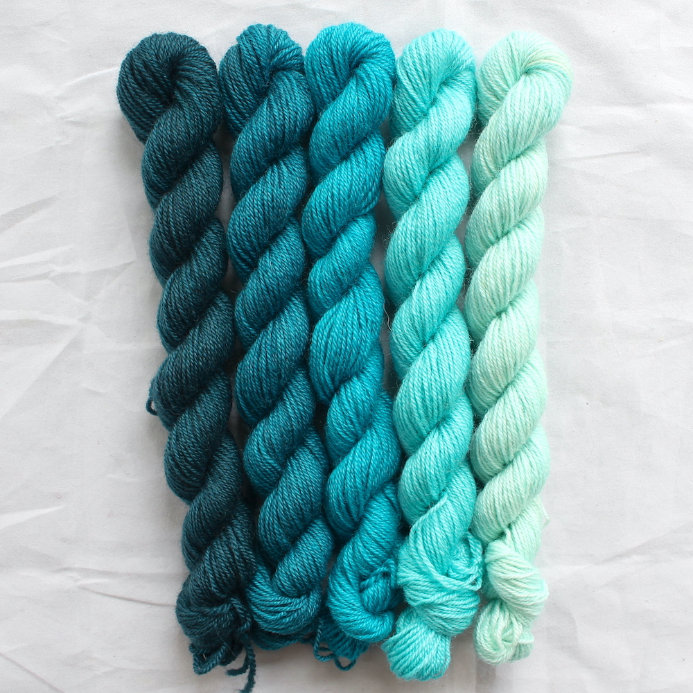 5 turquoise mini skeins in a gradient from dark to light