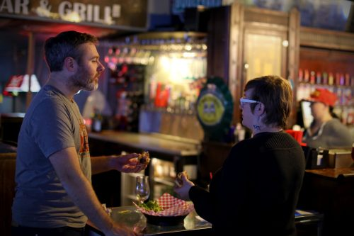 Patrons ordering drinks at Helen's North Kansas City dive bar