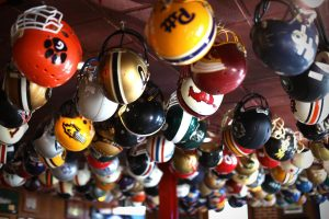 Wide variety of football helmets in a ceiling display at Chappell's, a sports bar and museum in Kansas City