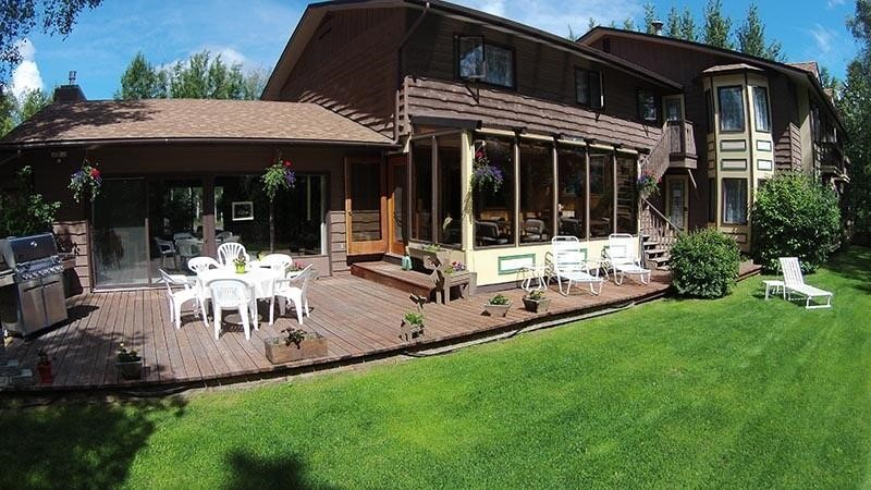 River Quest Residential Group Home provides luxurious outdoor amenities such as a hobby farm, hot tub, outdoor activities, and a river deck on the Kenai River in Soldotna, AK zip code 99669