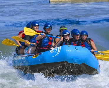 Image of group whitewater rafting at RIVERSPORT Rapids