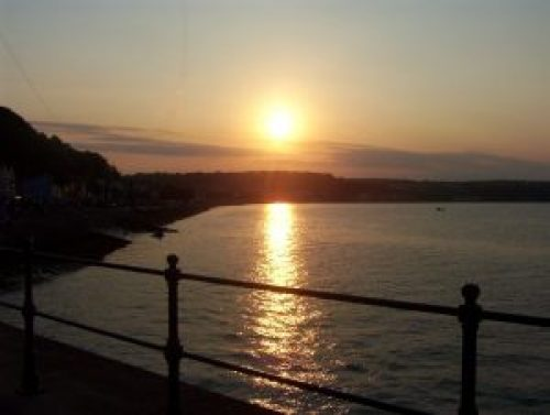 "alt=""Mumbles at sunset, Swansea, South Wales by Tourism Swansea Bay"""