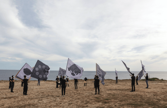 """ANDRECO, PARADE FOR THE LANDSCAPE. Collective performance for the project """"INVESTIGATION ON THE EXTREME LAND"""" produced by Ramdom, Progetto GAP. in S.M. di Leuca. Photo: Andreco e Yacine Benseddik"""
