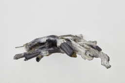 Giulia Cenci, Aprile 15000, 2017, metal bar, silicone rubber, fragments of mechanical components, black bones, marble dust, clay, cm 25 x 75 x 37