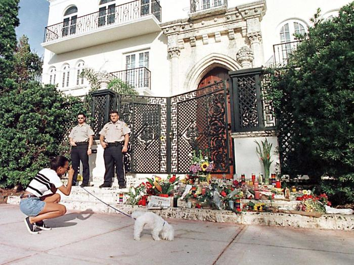 Private security guards stand in front of the hous