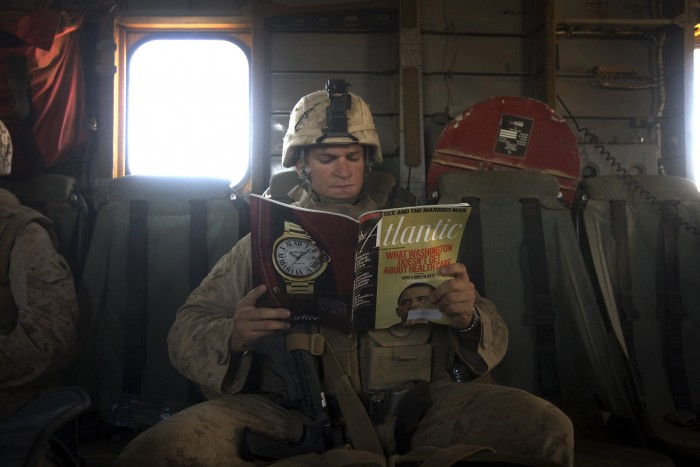 A US Marine reads a copy of Atlantic mag