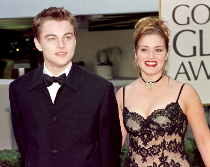 Actor Leonardo DiCaprio (L) arrives with actress a