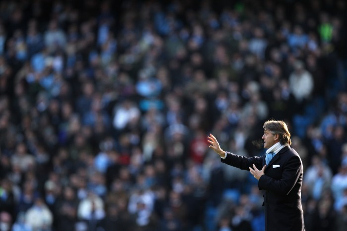 MANCHESTER, ENGLAND - JANUARY 31: Manchester City Manager Roberto Mancini gestures during the Barclays Premier League match between Manchester City and Portsmouth at the City of Manchester Stadium on January 31, 2010 in Manchester, England. (Photo by Richard Heathcote/Getty Images)