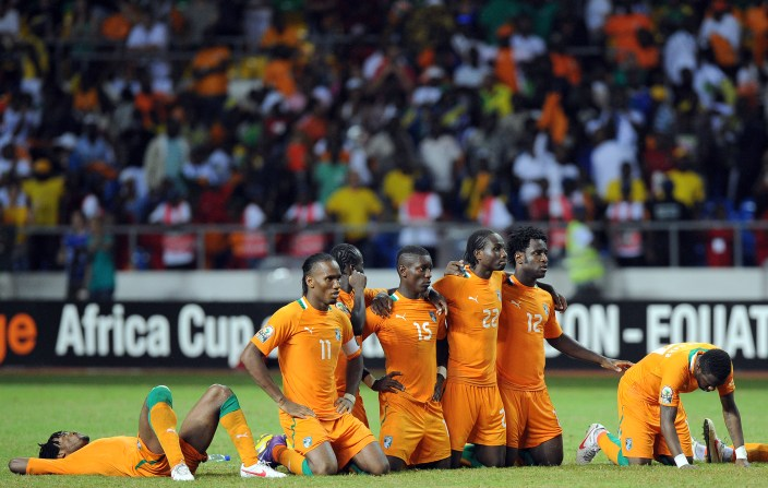 Ivory Coast national football team players react with disappointement after losing the African Cup of Nations final football match between Zambia and Ivory Coast on February 12, 2012, at the Stade de l'Amitie in Libreville. Zambia won the match during the final penalty shootout. AFP PHOTO / FRANCK FIFE (Photo credit should read FRANCK FIFE/AFP/Getty Images)