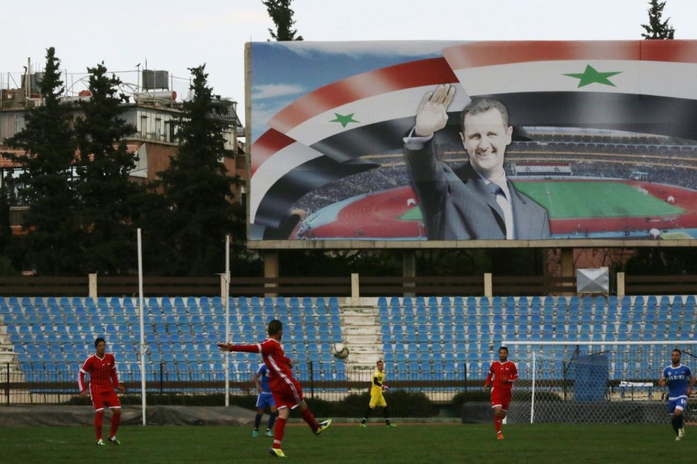 Un poster di Assad a Damasco, marzo 2016 (Louai Beshara/Afp/Getty Images)