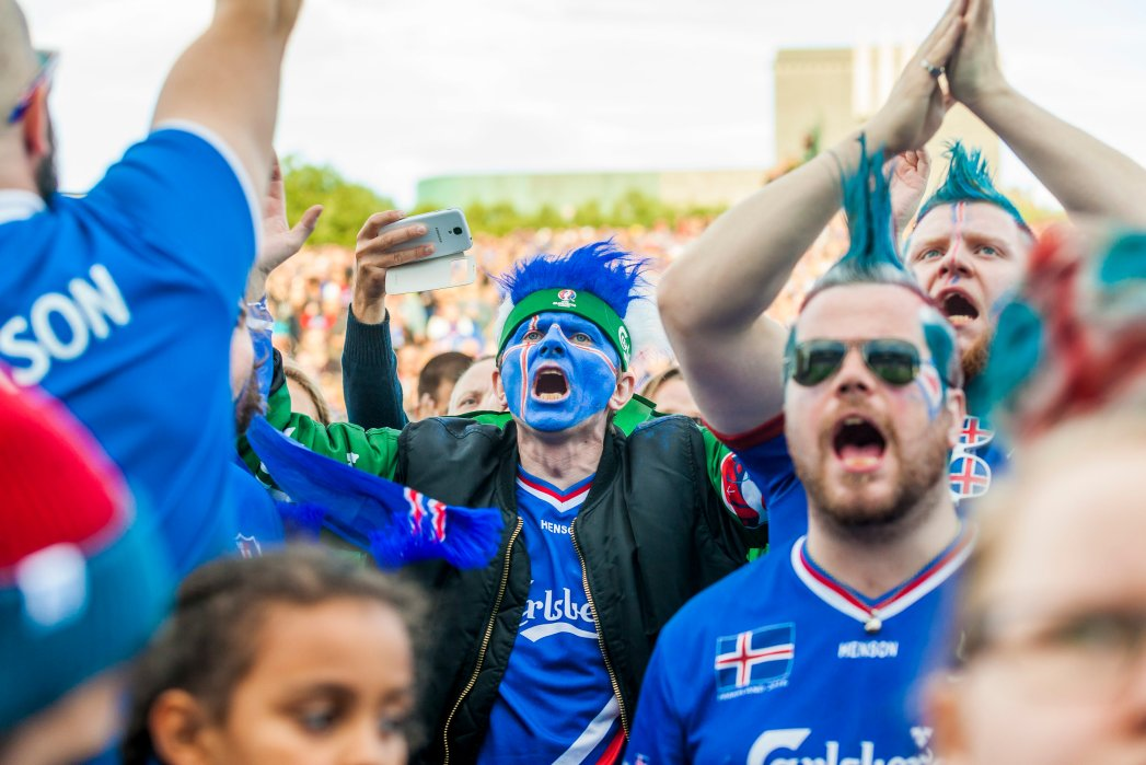 Iceland's fans react during the public screening of the quater final EURO 2016 football match against France, in Reykjavik, Iceland, on July 3, 2016. The quarter final match played in Saint-Denis, near Paris. / AFP / Karl Petersson (Photo credit should read KARL PETERSSON/AFP/Getty Images)
