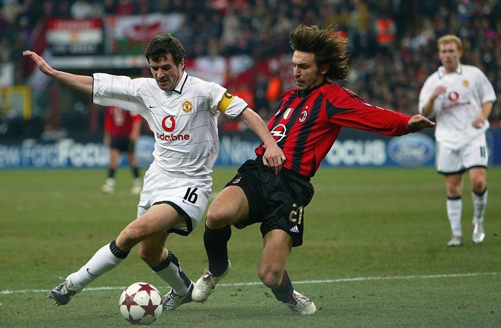 MILAN, ITALY - MARCH 8: Roy Keane of Manchester United and Andrea Pirlo of Milan tussle in the Penalty box during the Champions League last 16, second leg match between Milan and Manchester United at the San Siro on March 8, 2005 in Milan, Italy. (Photo by Phil Cole/Getty Images)