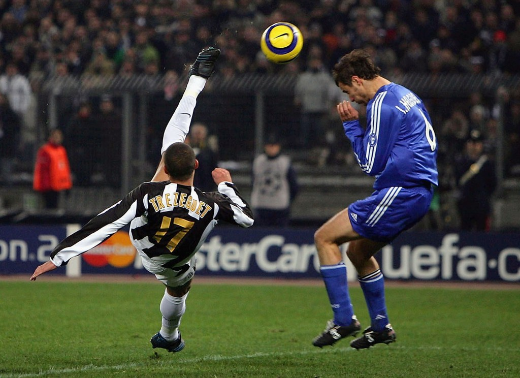TURIN, ITALY - MARCH 9: David Trezeguet of Juventus scores with a spectacular overhead kick which Ivan Helguera of Real Madrid cannot block during the UEFA Champions League first knock-out round, second leg between Juventus and Real Madrid on March 9, 2005 at the San Siro Stadium in Milan, Italy. (Photo by Mike Hewitt/Getty Images)