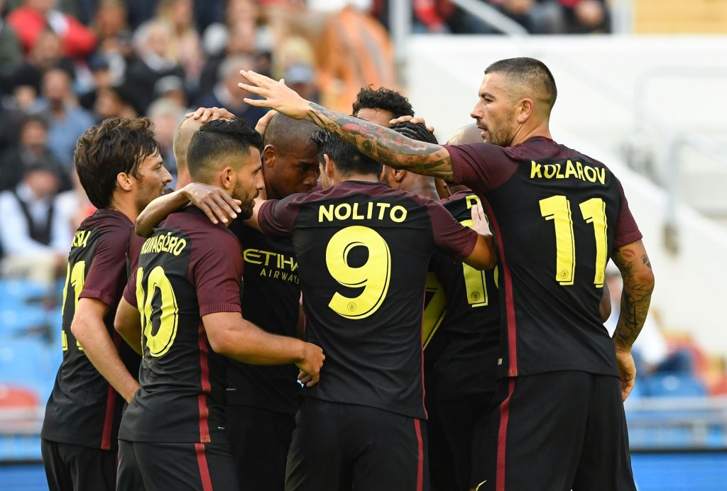 Manchester City's Argentinian forward Sergio Aguero (2nd L) celebrates with his teammates after scoring during the friendly football match between Arsenal and Manchester City at the Ullevi stadium in Gothenburg on August 7, 2016. / AFP / JONATHAN NACKSTRAND (Photo credit should read JONATHAN NACKSTRAND/AFP/Getty Images)