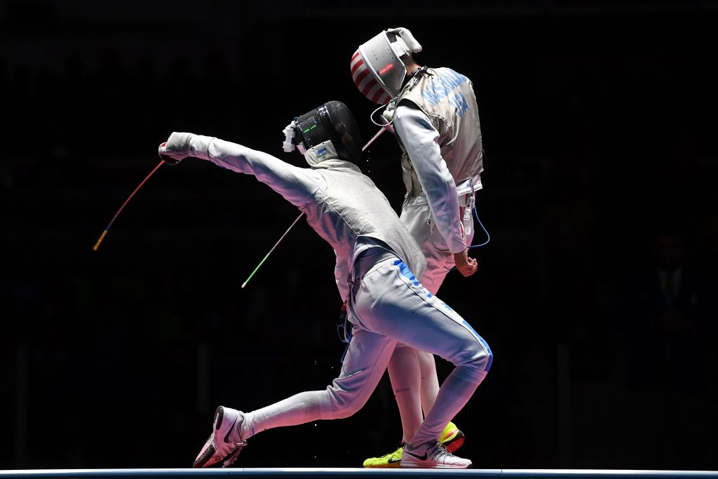TOPSHOT - US Alexander Massialas (R) competes against Italy's Daniele Garozzo during the mens individual foil gold medal bout as part of the fencing event of the Rio 2016 Olympic Games, on August 7, 2016, at the Carioca Arena 3, in Rio de Janeiro. / AFP / Kirill KUDRYAVTSEV (Photo credit should read KIRILL KUDRYAVTSEV/AFP/Getty Images)